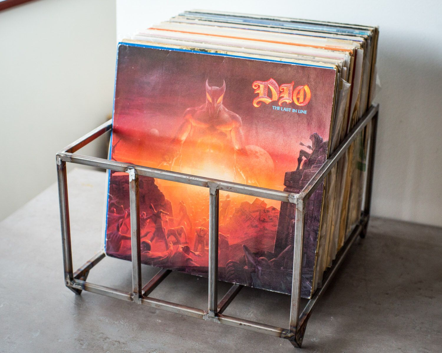 A personal favorite from my Etsy shop https://www.etsy.com/listing/386190750/12-vinyl-lp-record-storage-metal-crate
