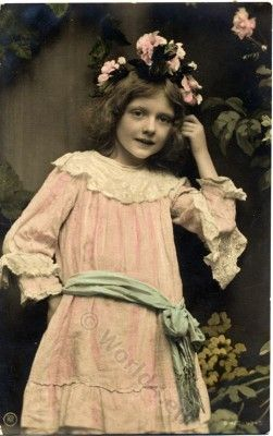 Dressing of Alice in Wonderland. German girls dress. Vintage child clothing