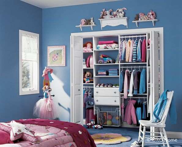 A closet to grow with your child by replacing three wardrobe rods with two. Shelves and baskets help keep kids' toys organized.