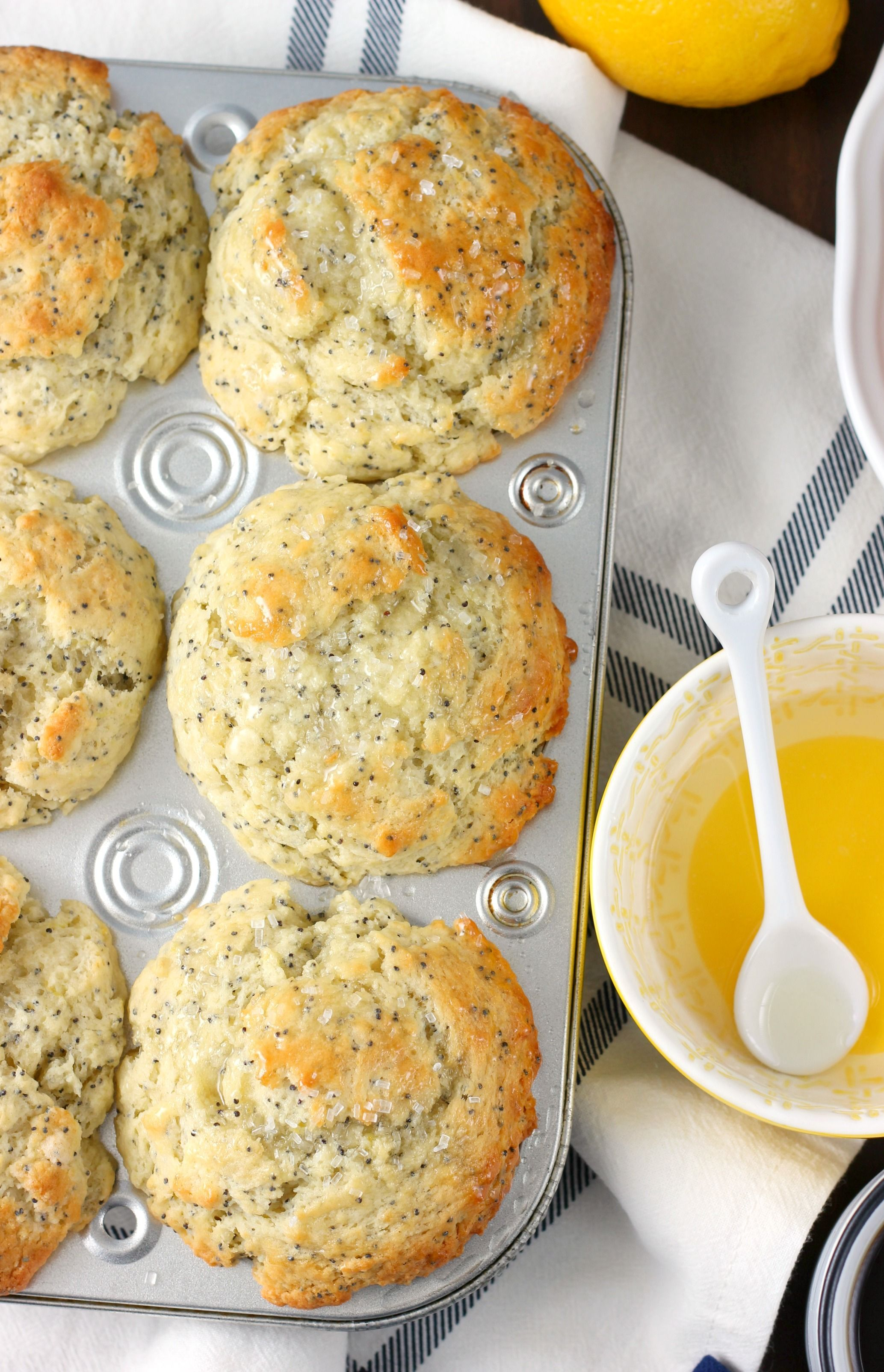Bakery Style Lemon Poppy Seed Muffins are perfectly sweetened and tender with a tart lemon glaze and sprinkling of coarse sugar.