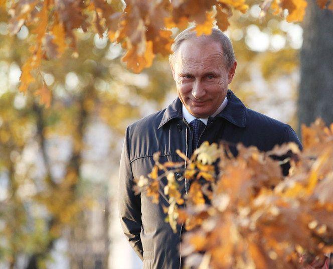 Russian President Vladimir Putin walks in the park at estate of the Romantic writer Mikhail Lermontov in Tarkhan