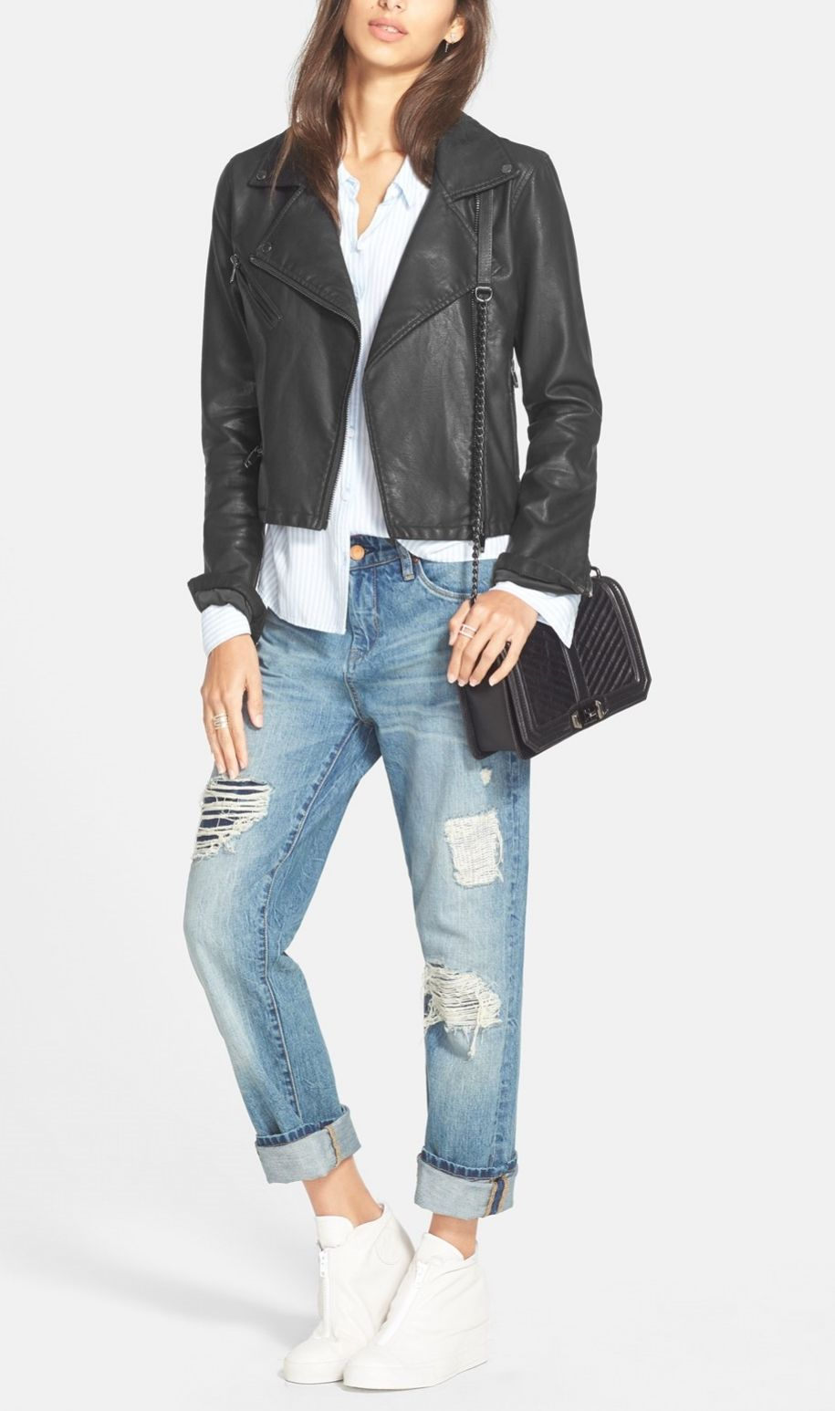 The faux leather jacket styled with boyfriend jeans, a quilted crossbody bag and sneakers is the perfect, casual with-a-hint-of-edge outfit.