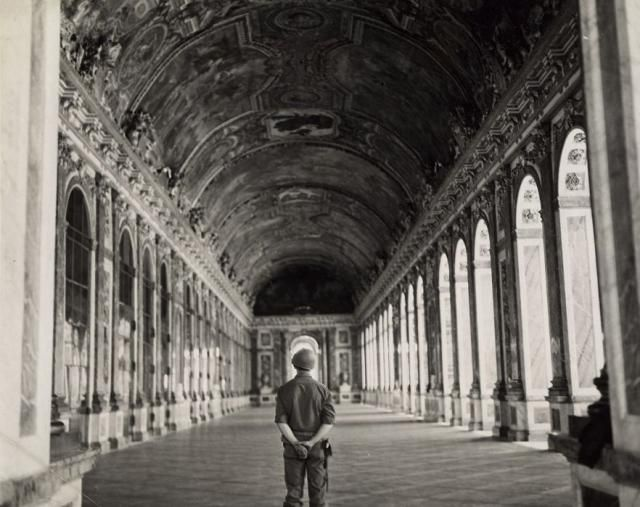 The Power of Place: Versailles: Historic photo of WWII American soldier in the Hall of Mirrors, Versailles, 1944