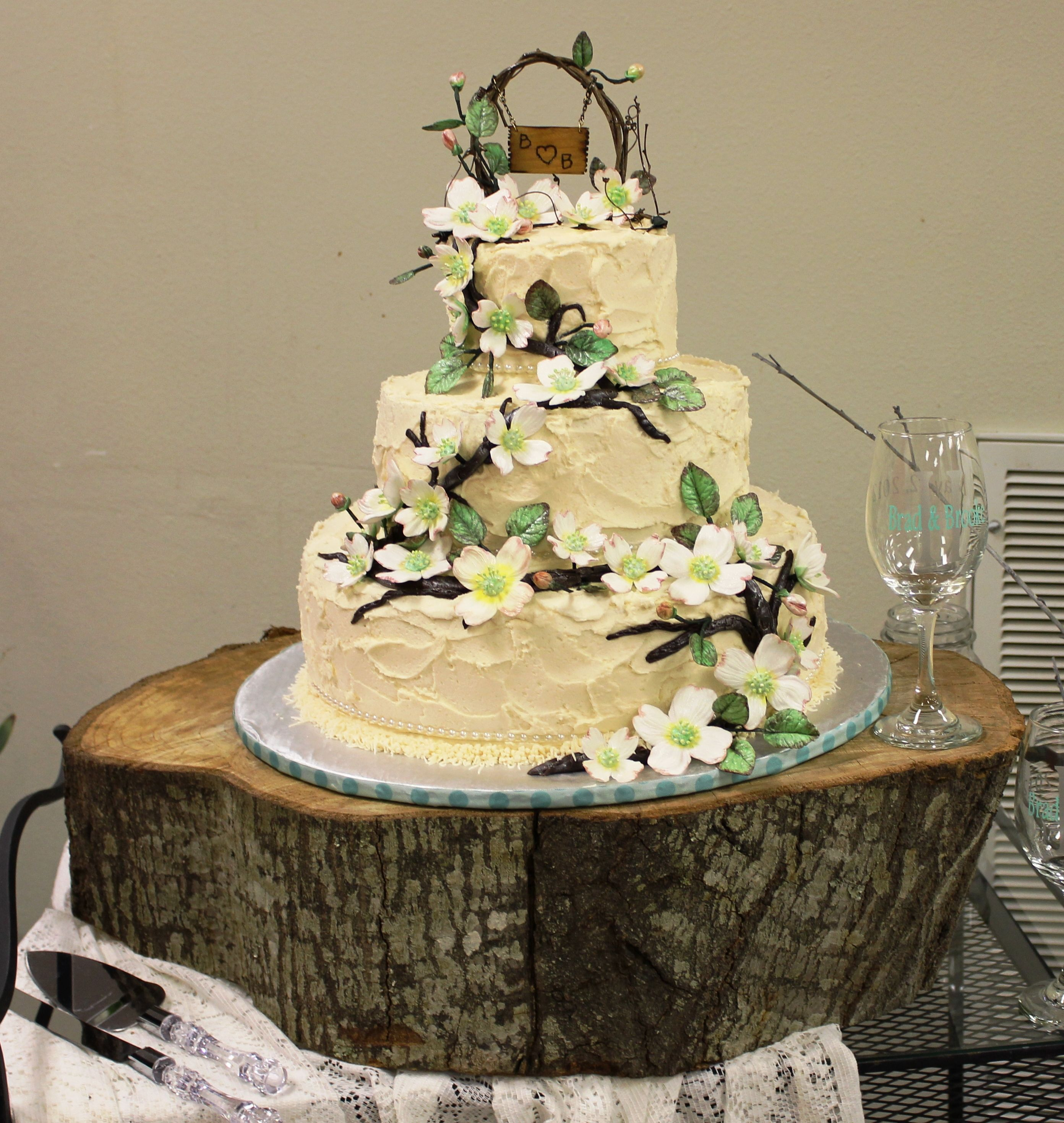 Rustic and woodsy wedding cake with custom grapevine topper, and ...