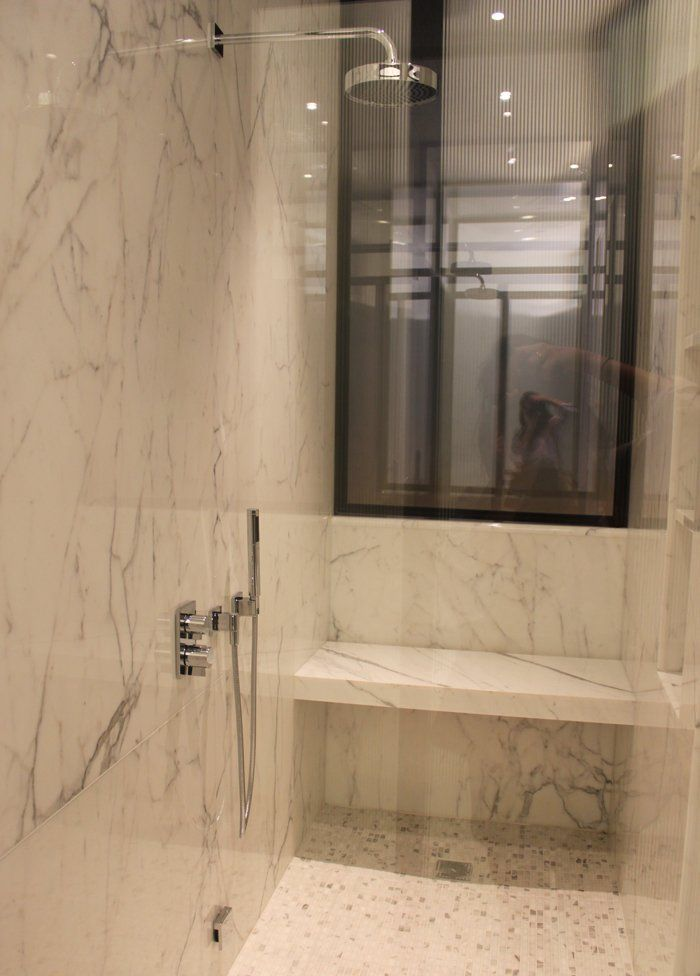 marble shower with bench. long arm to make a rain shower head ...