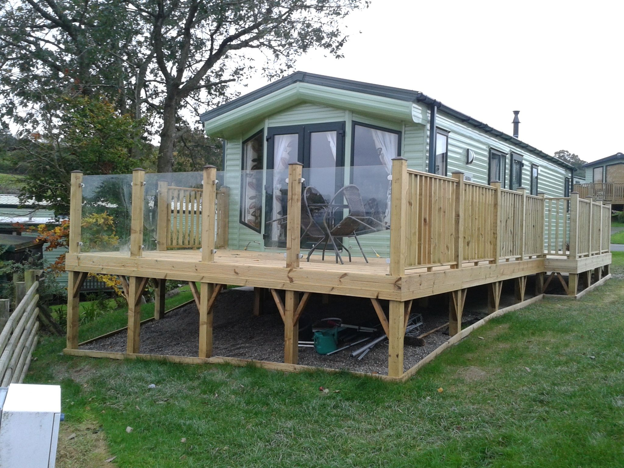 Caravan park glass panels for decking balustrades and for Garden decking glass panels