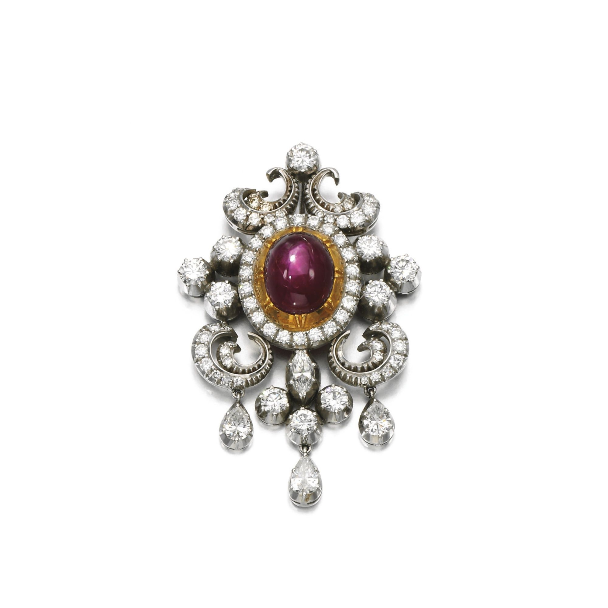 Star ruby and diamond brooch pendant set with a star ruby within a