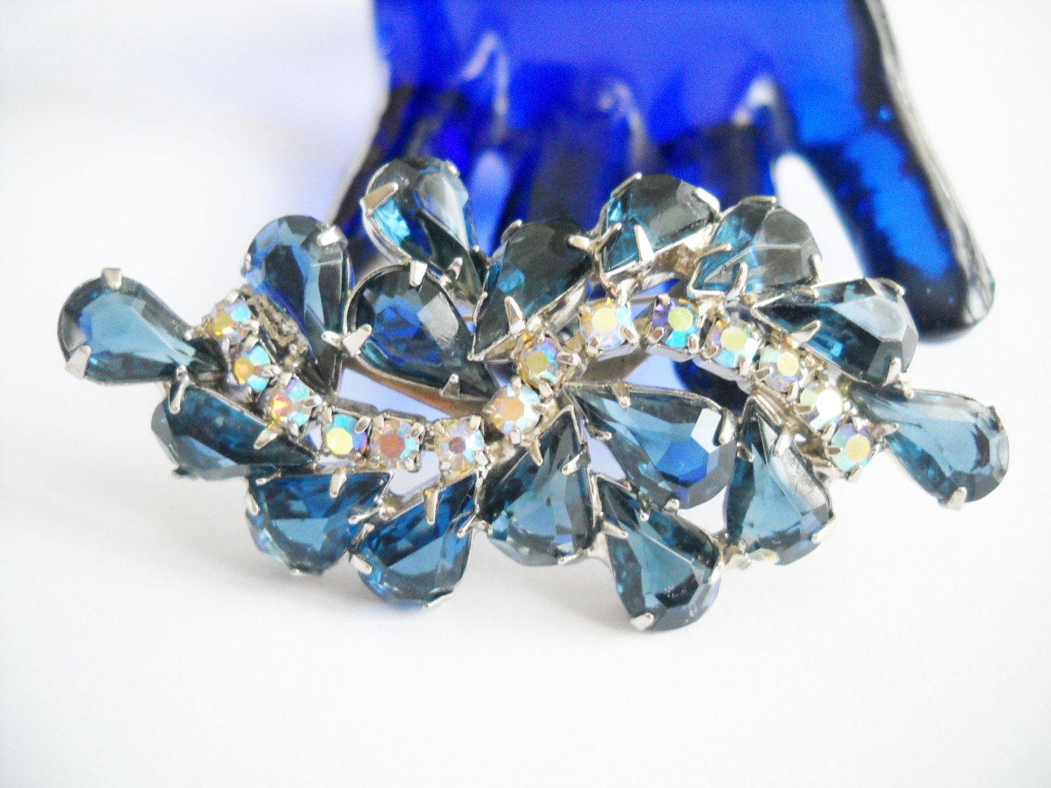 Vintage Brooch Sapphire Teardrop Blue Open Backed Rhinestones Prong Set Aurora Borealis Hollywood Regency Mid Century by FindCharlotte on Etsy