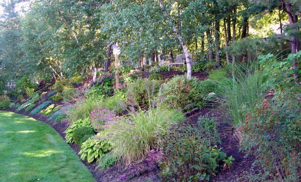 Summer S End In New England Backyard Hill Landscaping Sloped Garden Backyard Landscaping