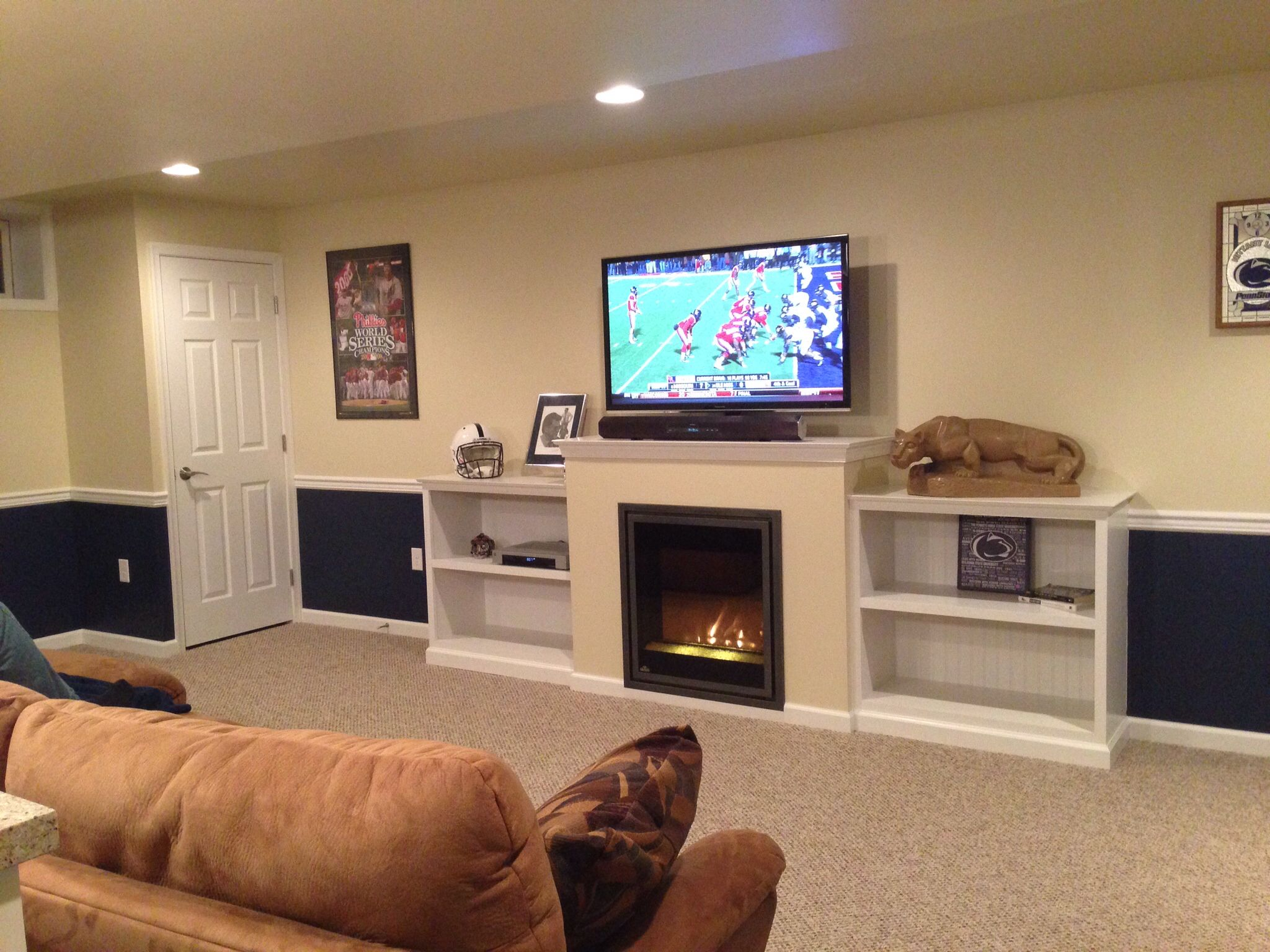 built in shelving entertainment center with electric fireplace