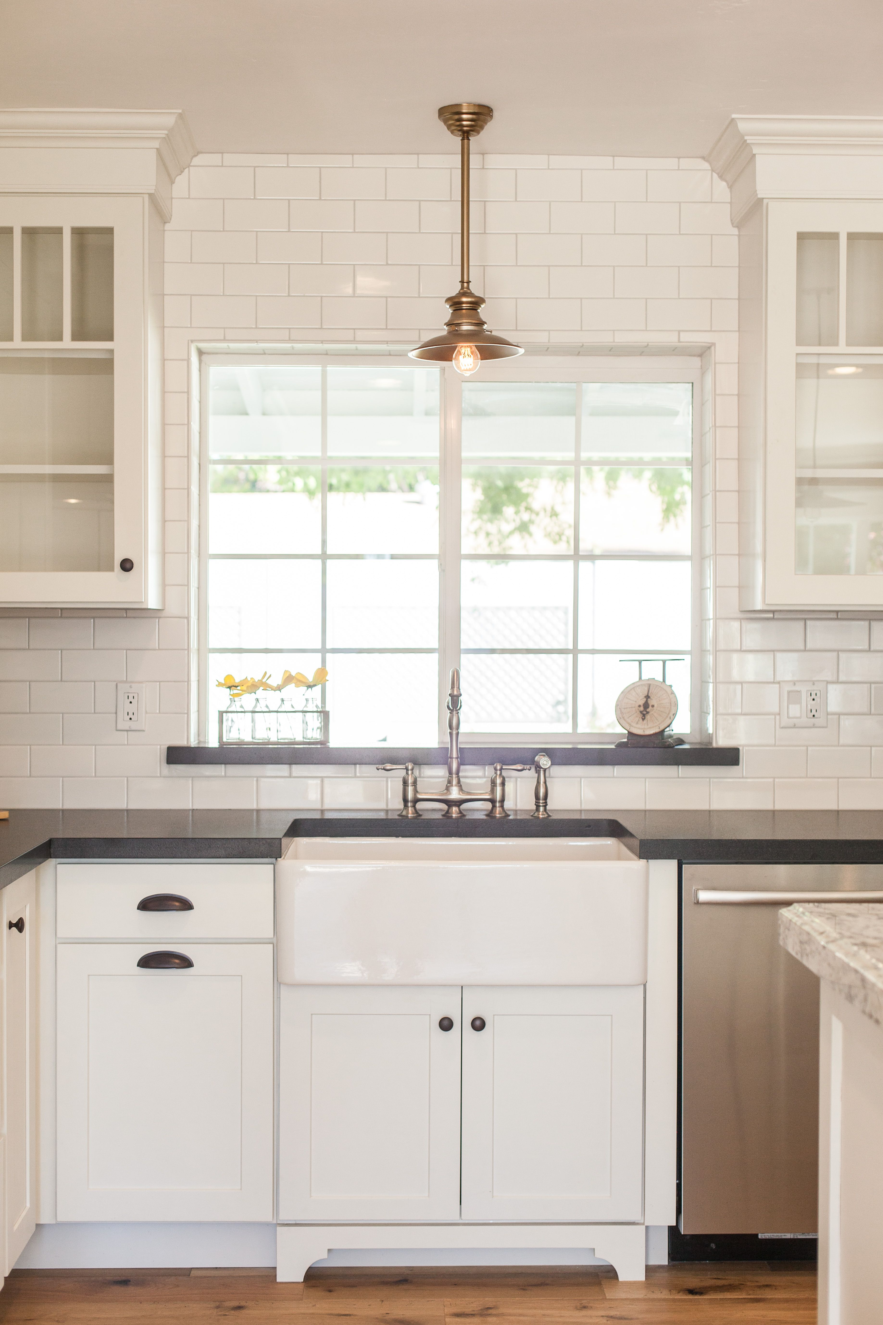 Farmhouse Sink Subway Tile Around Window / Pendant Light