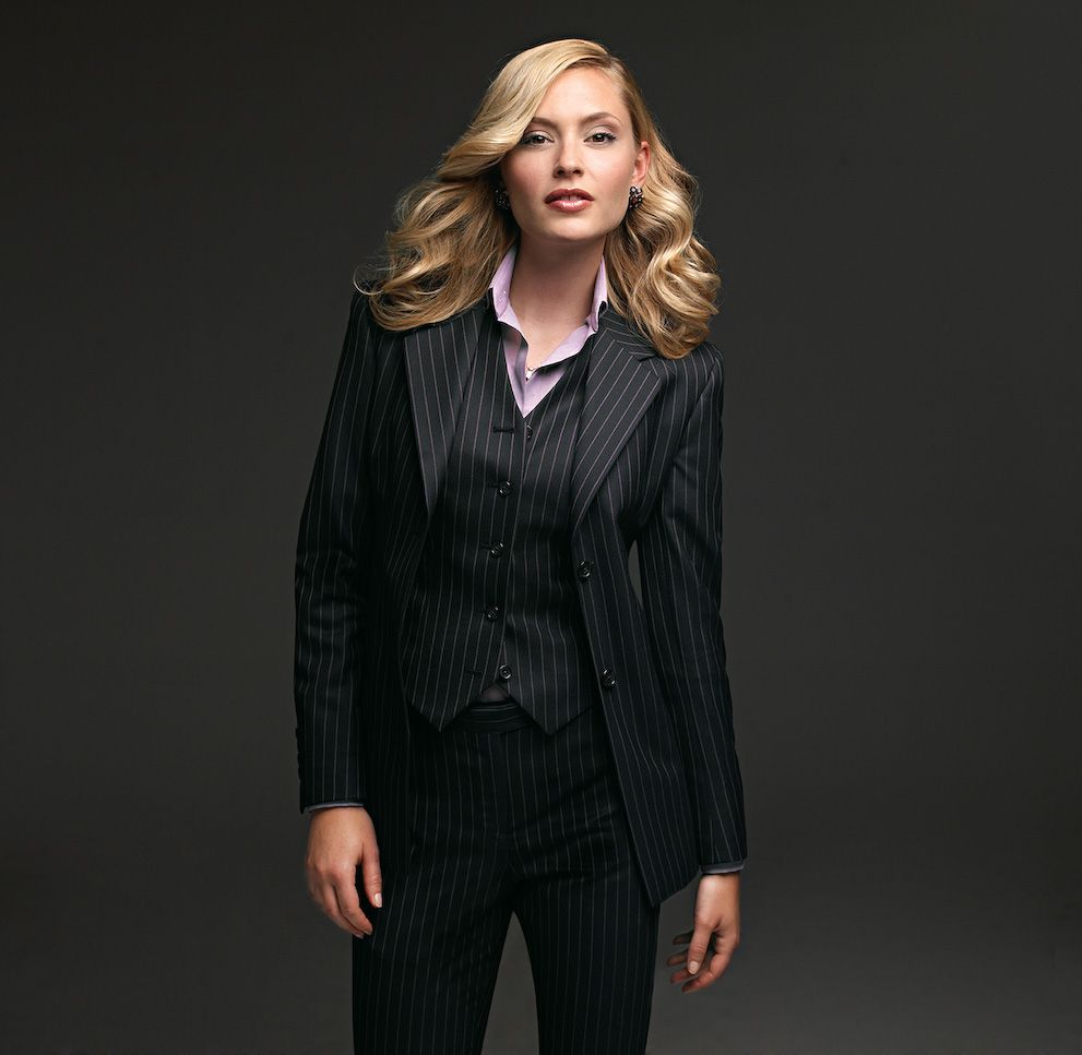 I have often wondered if women rock a 3-piece suit!   If this was a lil' more tapered?   Plus, I'm not really liking how the vest fits on this model.  But overall, I like the idea of a woman's 3-piece suit.