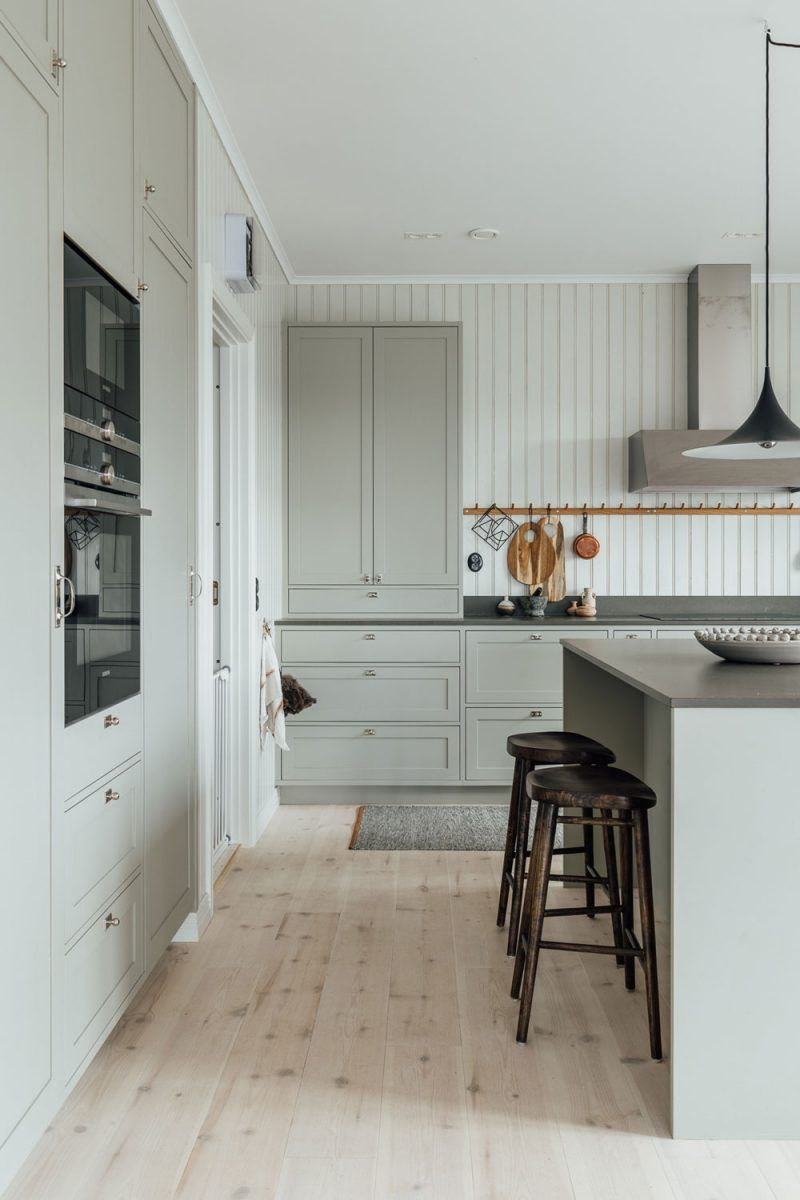 The Newly Renovated Summer House of Minna Jones in Finland - Country style kitchen, Home, Kitchen cabinet styles, Scandinavian home, Kitchen design, Swedish interiors - Light wooden panels and floors, huge windows, and beautiful view over the lake and the surrounding Finnish nature  Gorgeous!