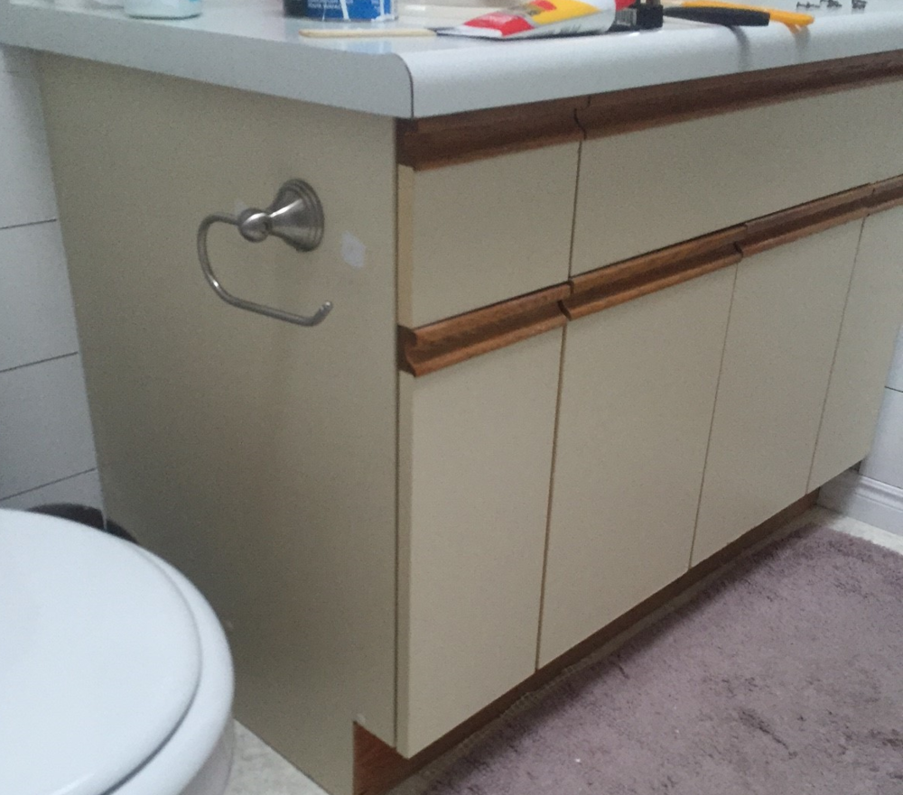 Refinishing Laminate Bathroom Cabinet Door: Bathroom Update + How To Paint Laminate Cabinets