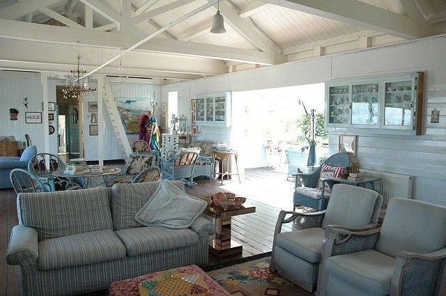 A beach cottage interior; plenty of seating for family and friends ...