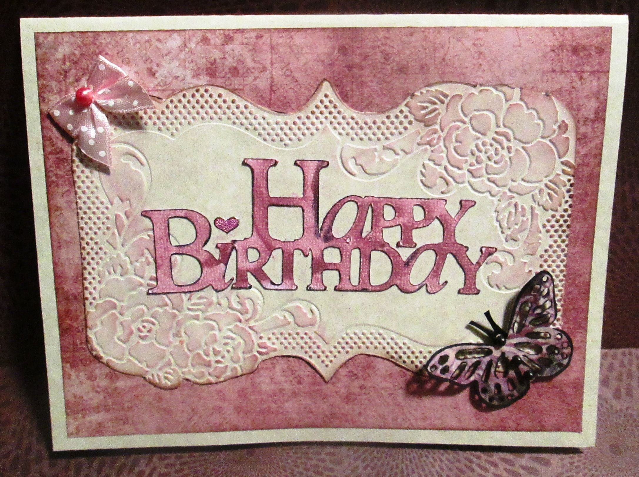 Pink floral embossed birthday card - March 2014