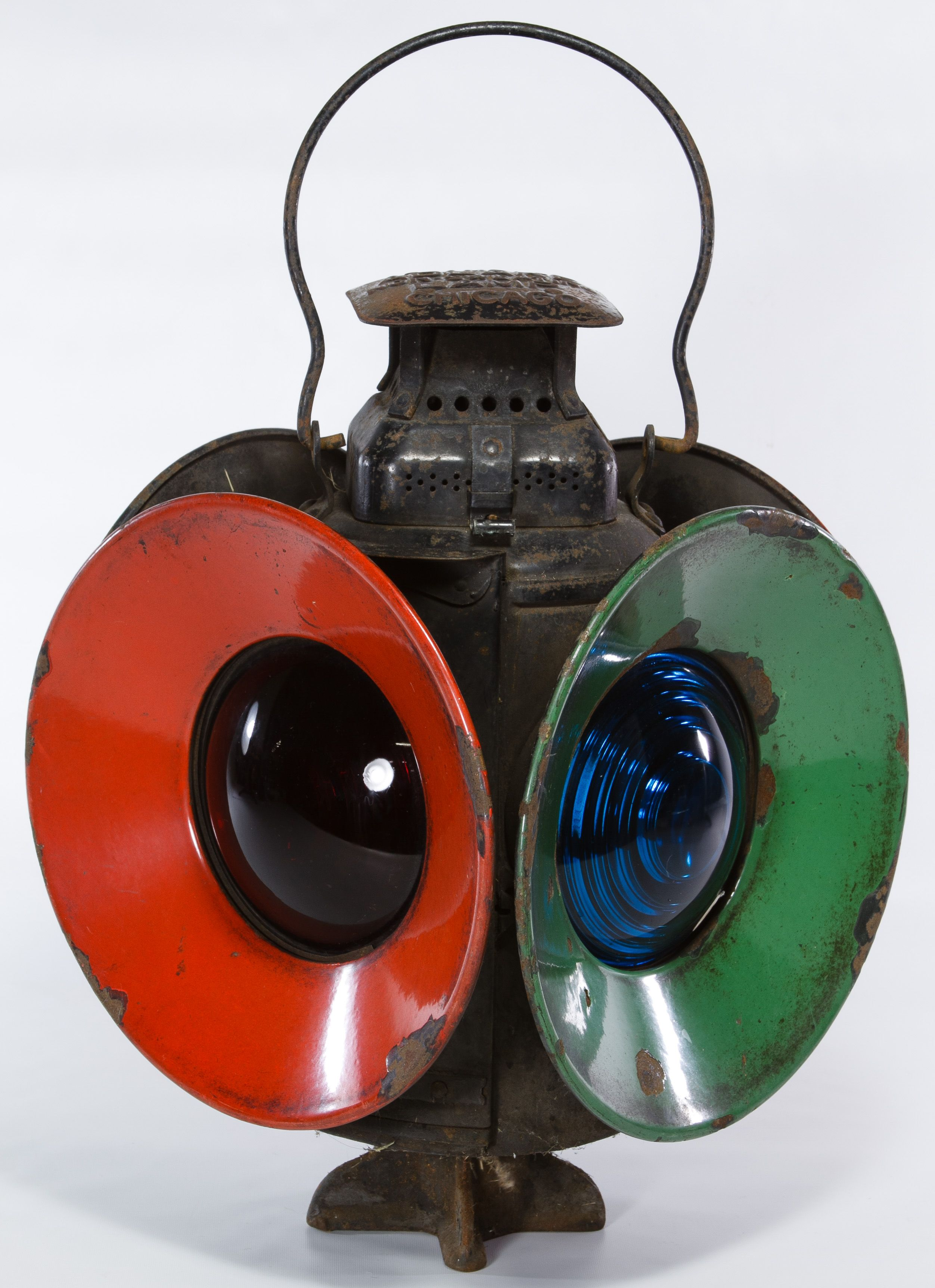 Lot 417: Adlake B&O Railroad Switch Lamp; Having two blue lights, two red lights, four reflectors, the railroad mark on the side of the vent and the maker mark on the cap