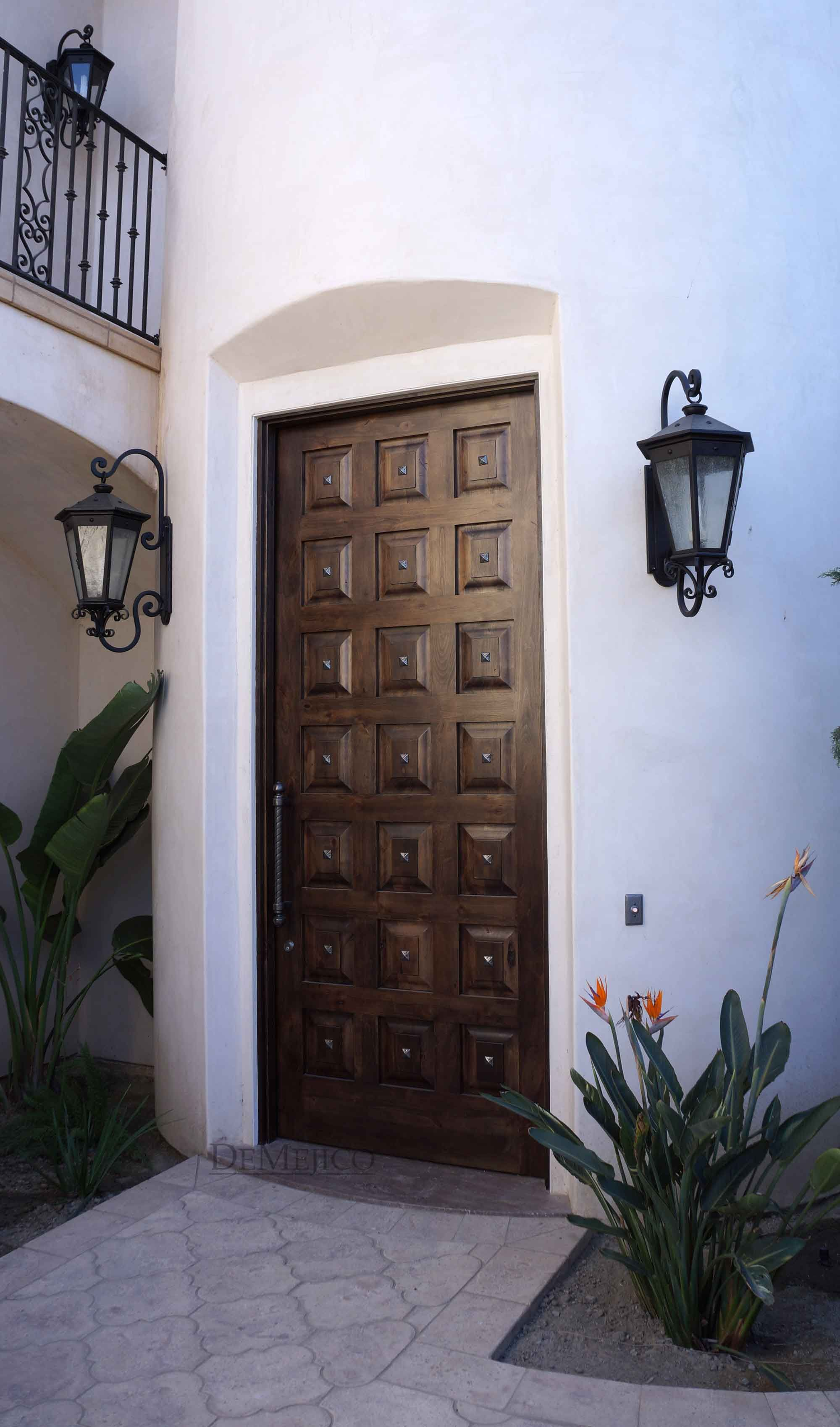 Classic Spanish Entry Door Complimented By Forged Wrought Iron