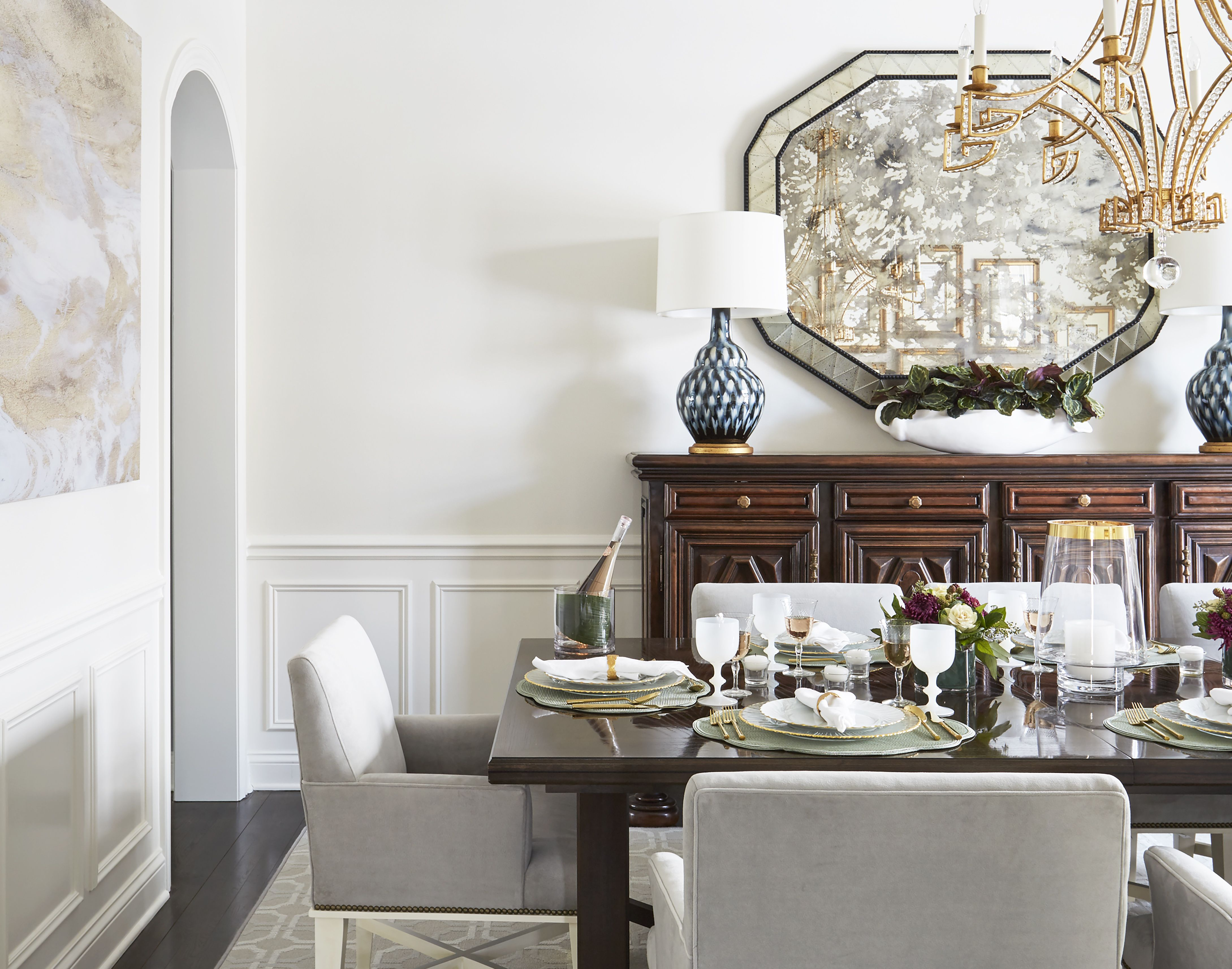 Dining Room With Grey Chairs And Chandelier Neutral Dining Room Mirror Dining Room Interior Design