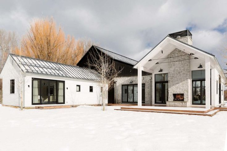 Modern farmhouse-inspired home with dramatic views of the Grand Tetons #modernfarmhousestyle