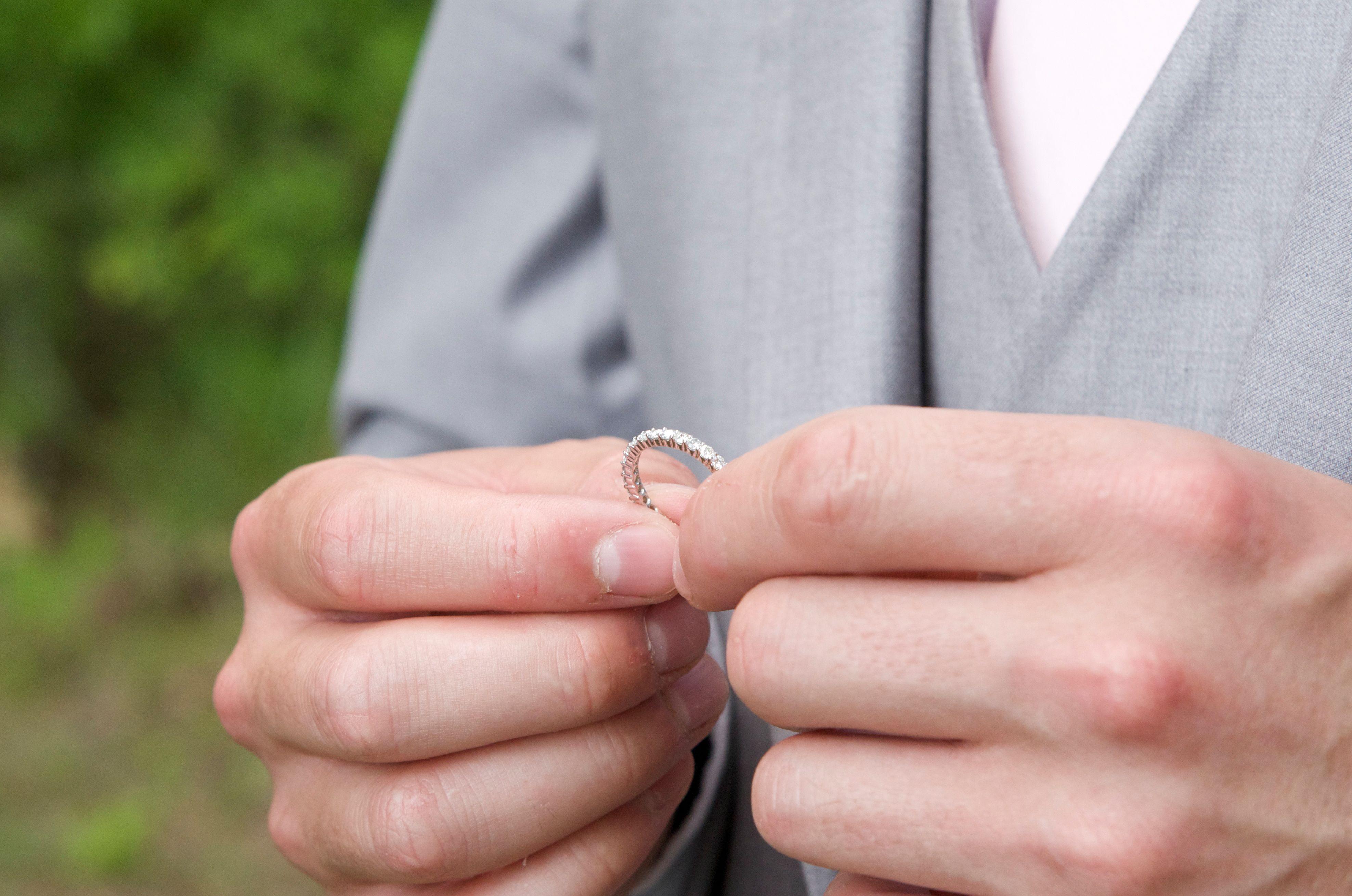 Groom admiring bride\'s wedding ring. Wedding Photography photo ideas ...