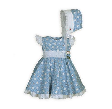 Delightful Daisy Plaid Newborn Girl's Dress The Wooden Soldier Exclusive with eyelet flutter sleeves. Removable handmade floral pin accents waistline. Button back closure. Knee length. Cornflower blue cotton brother-sister outfits. Dresses in blue plaid and white daisy vintage print. Cool and comfortable cotton sheeting. White eyelet trim. Full skirts with attached slips have white eyelet ruffle that dips below hemlines. Tie back sashes. Machine wash. USA made