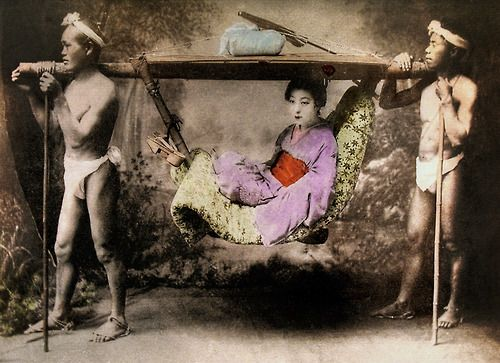 """Portrait of woman in palanquin - """"taxi."""" Hand-colored photo, c 1880's, Japan."""