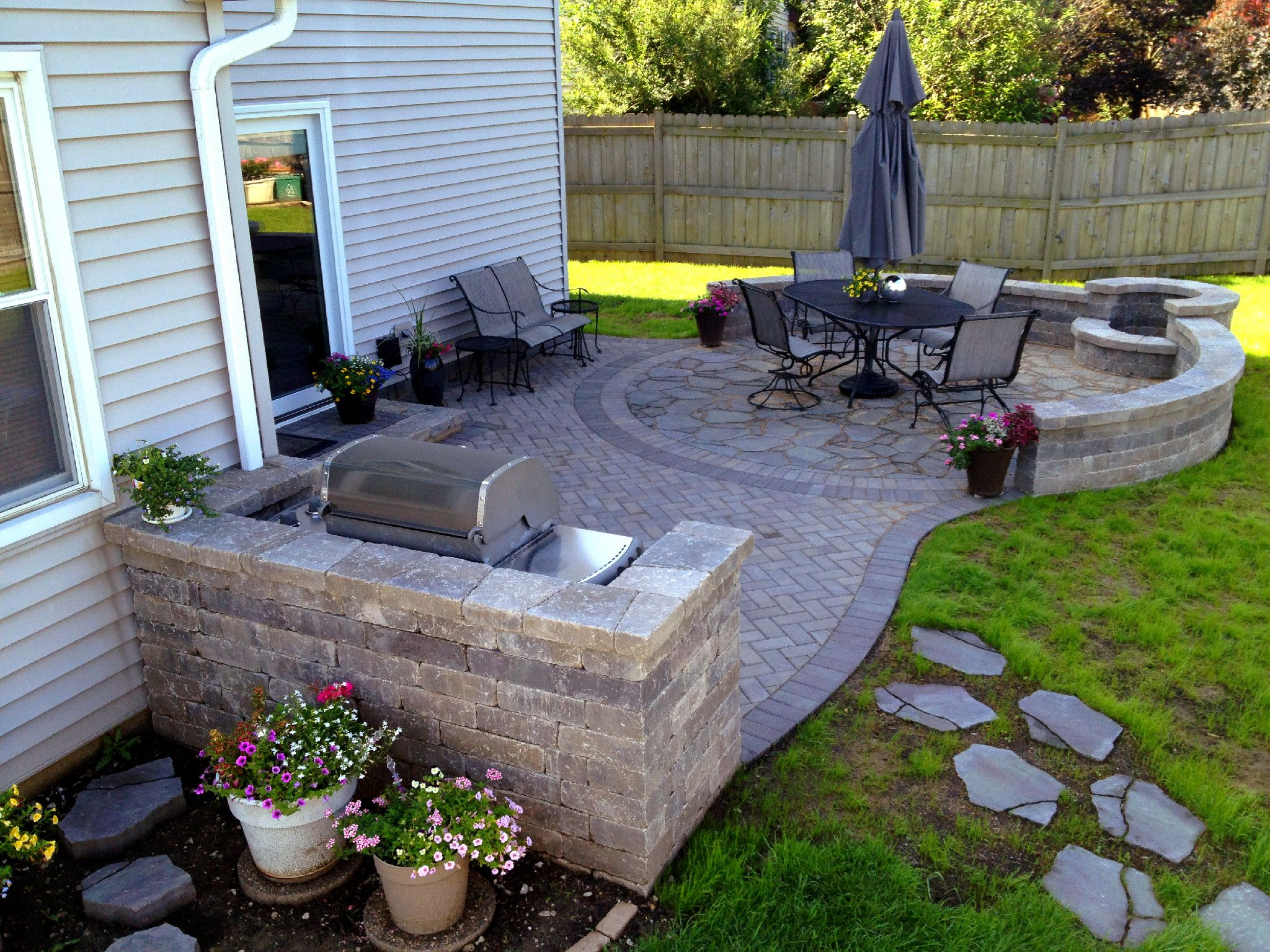Paver patio with grill surround and fire pit by hoffman for Paver patio ideas pictures