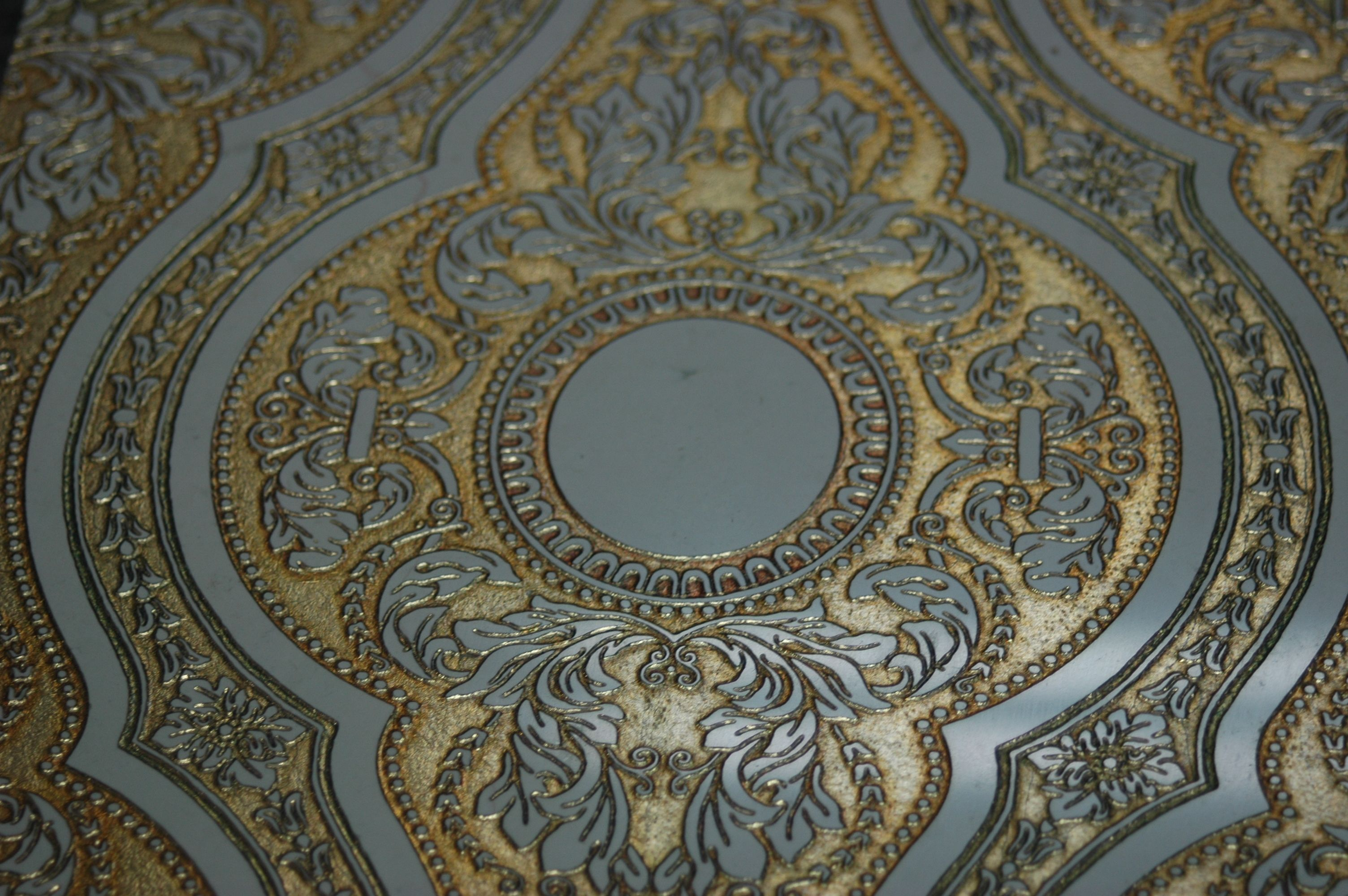 Alcor tile on marble decorated gold by AKROS