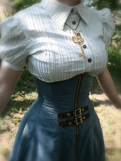 Steampunk.  I am totally digging how it's like a corset that becomes a skirt. And the color!