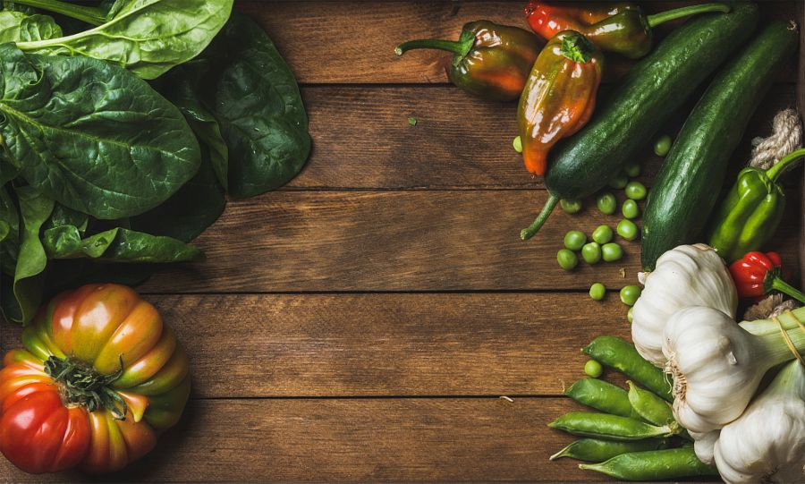 Fresh raw vegetable ingredients for healthy cooking or salad making on wooden background by Anna Ivanova - Photo 162820137 - 500px
