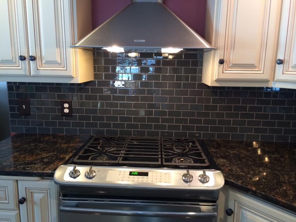 Gorgeous Kitchen Backsplash With Glass Tile Installed