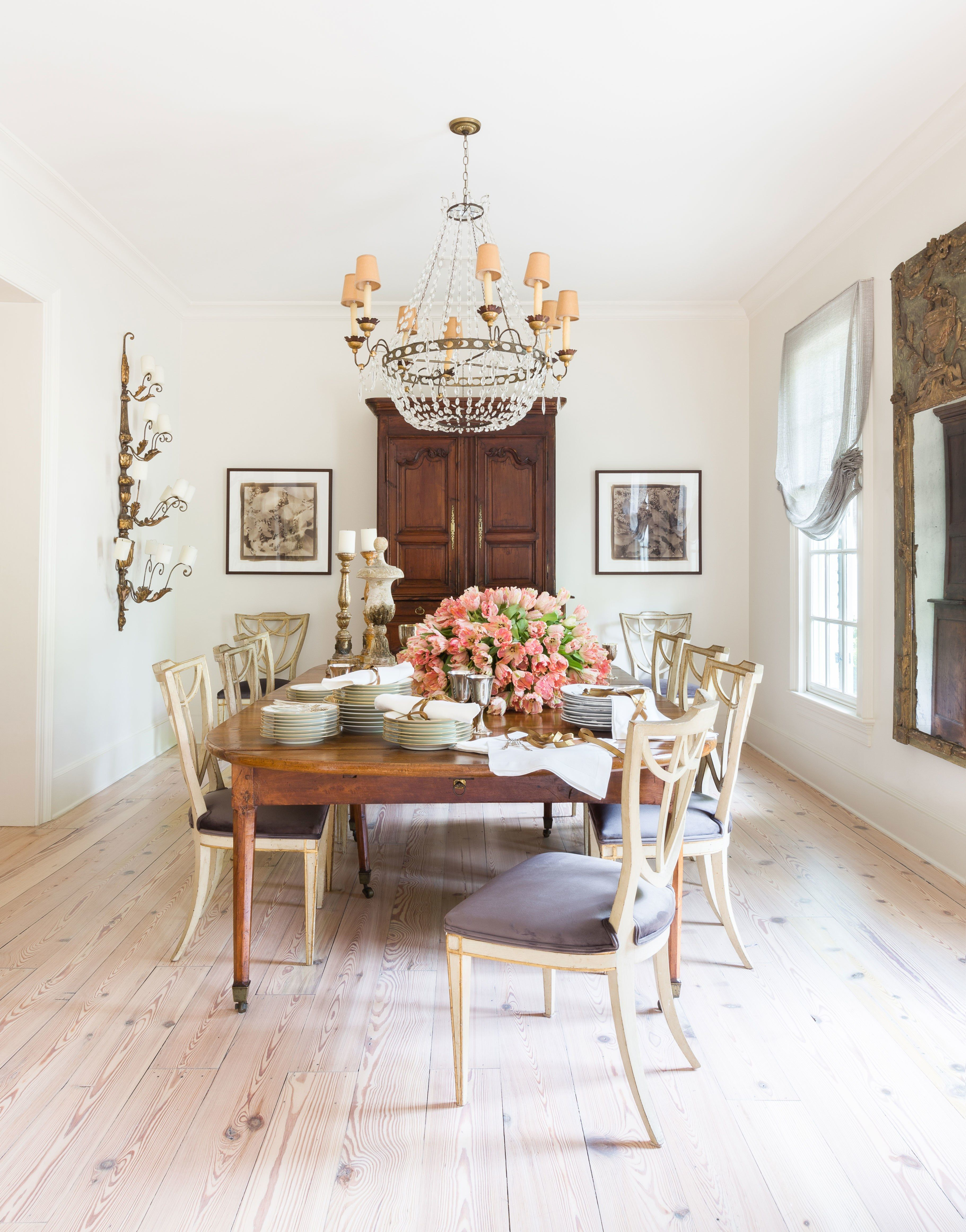A bright dining room with an heirloom french table and and antique armoire circa 1860 archdigest