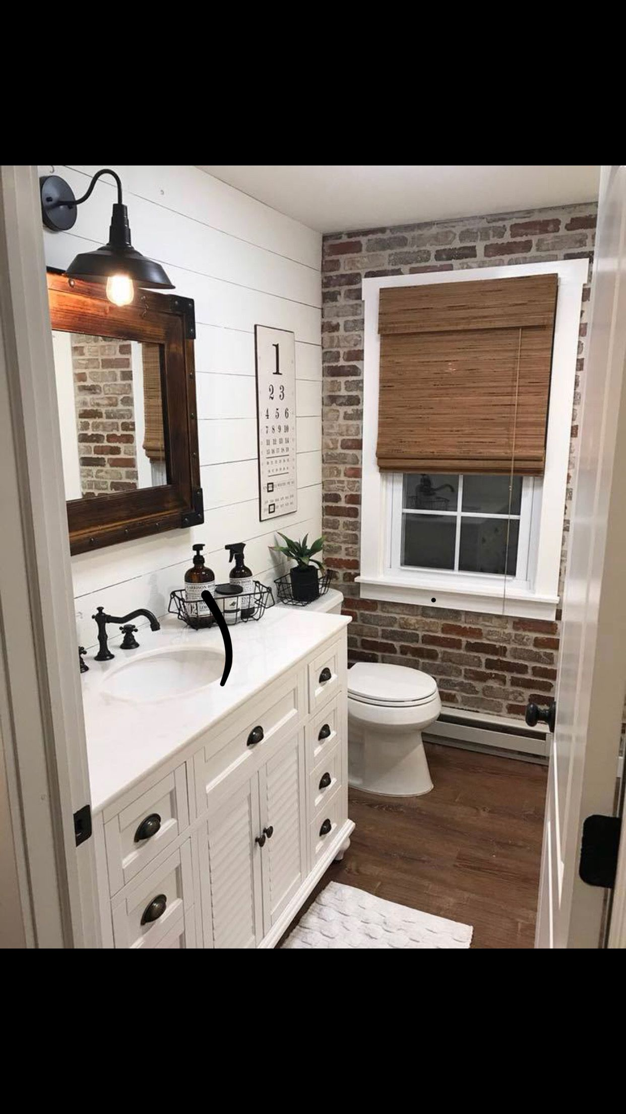 The Exposed Brick Is A Nice Contrast In This Half Bath