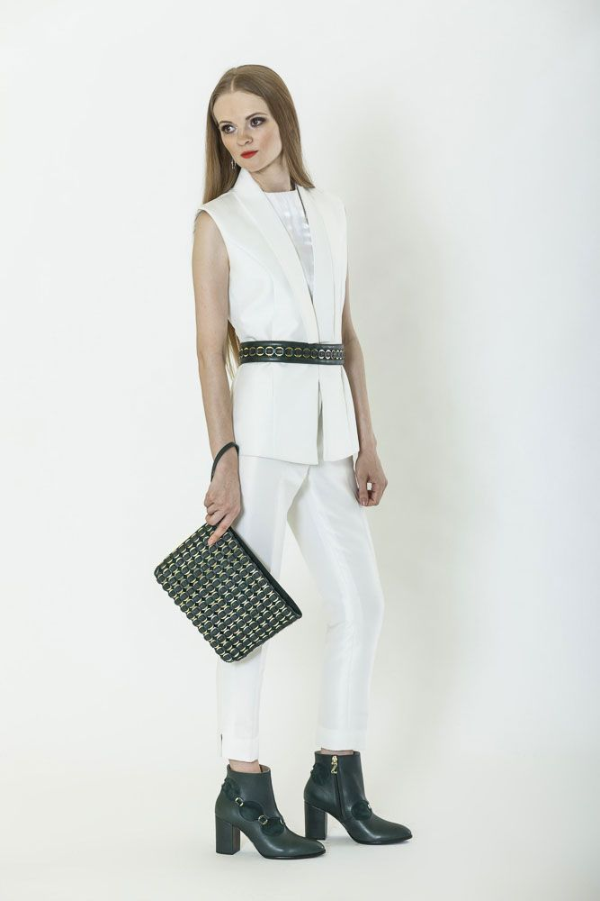 white dress with leather accessories