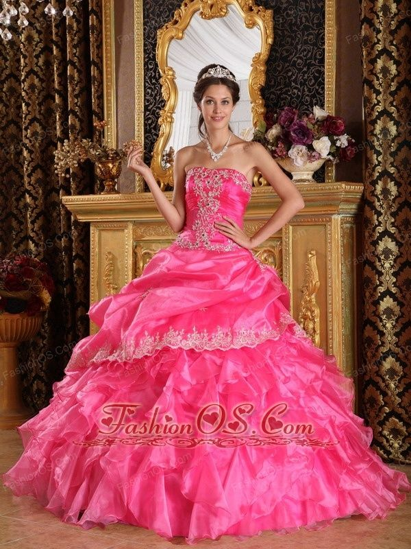 Beautiful Hot Pink Quinceanera Dress Strapless Organza Ball Gown  http://www.fashionos.com This hot pink quinceanera dress is so sweet.Silver embroidery at the strapless bust panel has wispy designs, and the fabric gathers throughout the mid-section to shape a delicate waist curve. Embroidered pick-ups accent the layered ballroom skirt with a bit of silvery shimmer. The fresh and vibrant pink hue creates a spring feeling.