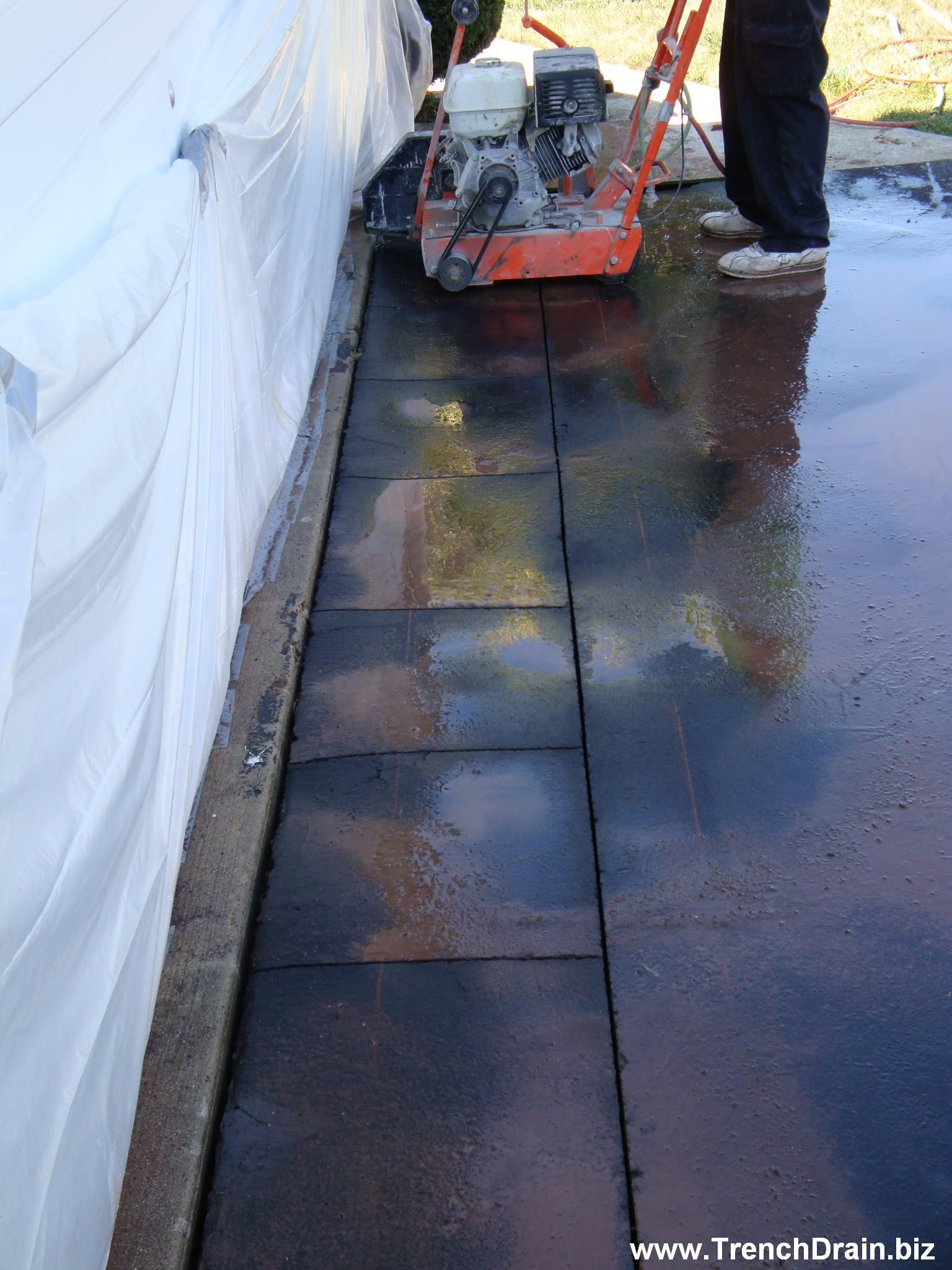 Trench Drain Installation For The Residential Driveway Trenchdrainblog Com Trench Drain Driveway Drain Drainage Grates