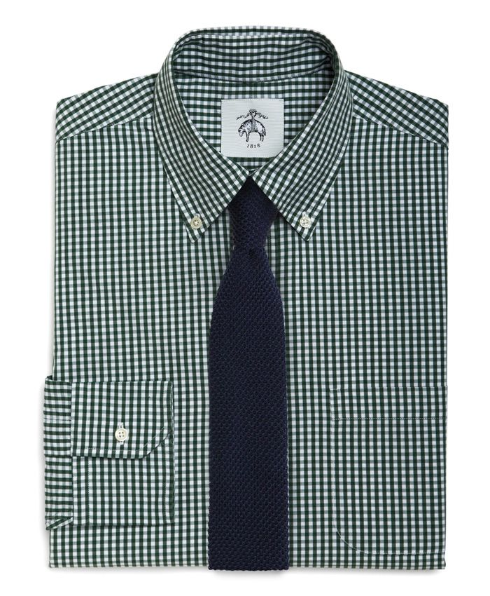 Accessorize green gingham with a navy knit tie.