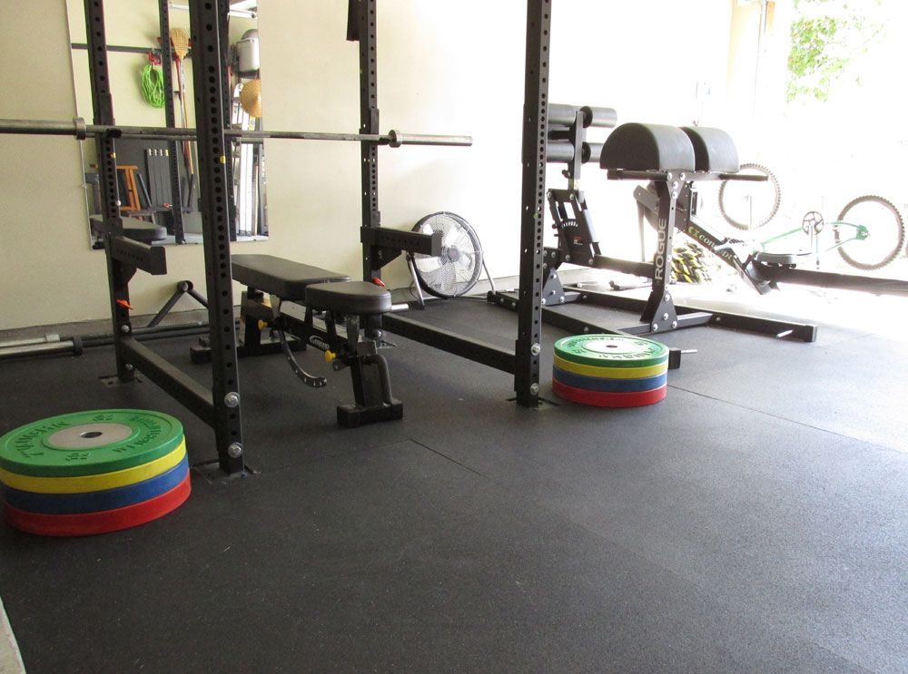 Working with securing stall mats in a garage gym garage