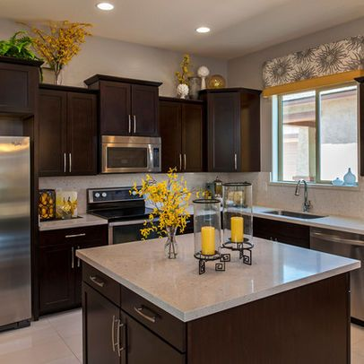Kitchen With Yellow Walls And Gray Cabinets