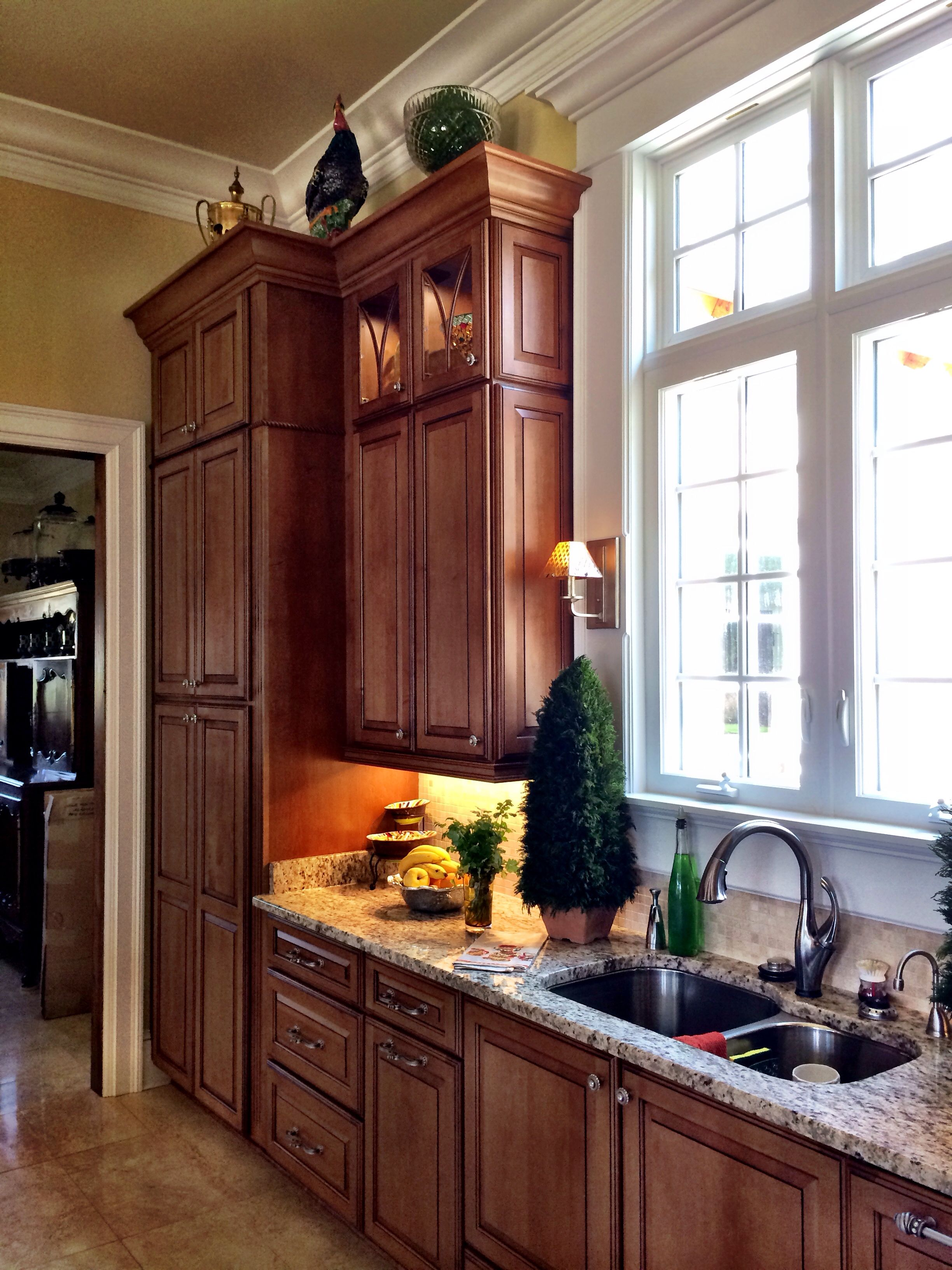 Wall pantry unit and kitchen sink area 12 foot ceilings schuler cabinetry design by scott herrin lowes kitchen designer