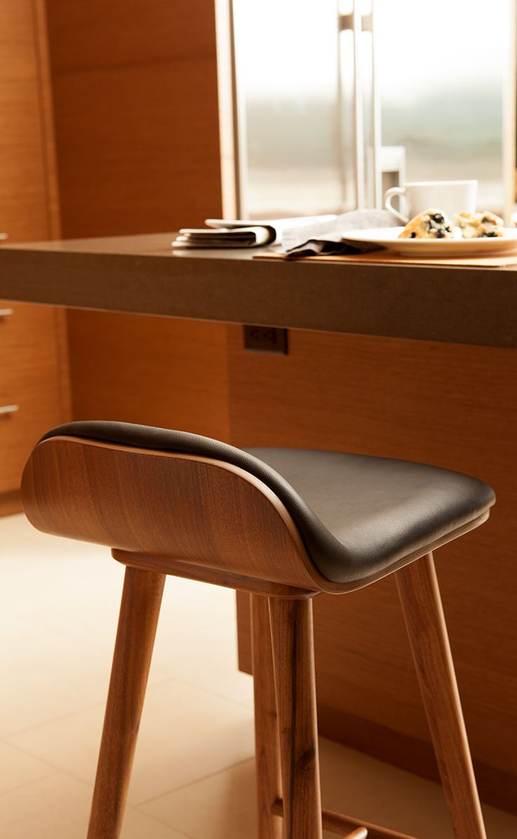 Cool but inconspicuous the sede leather and walnut barstool