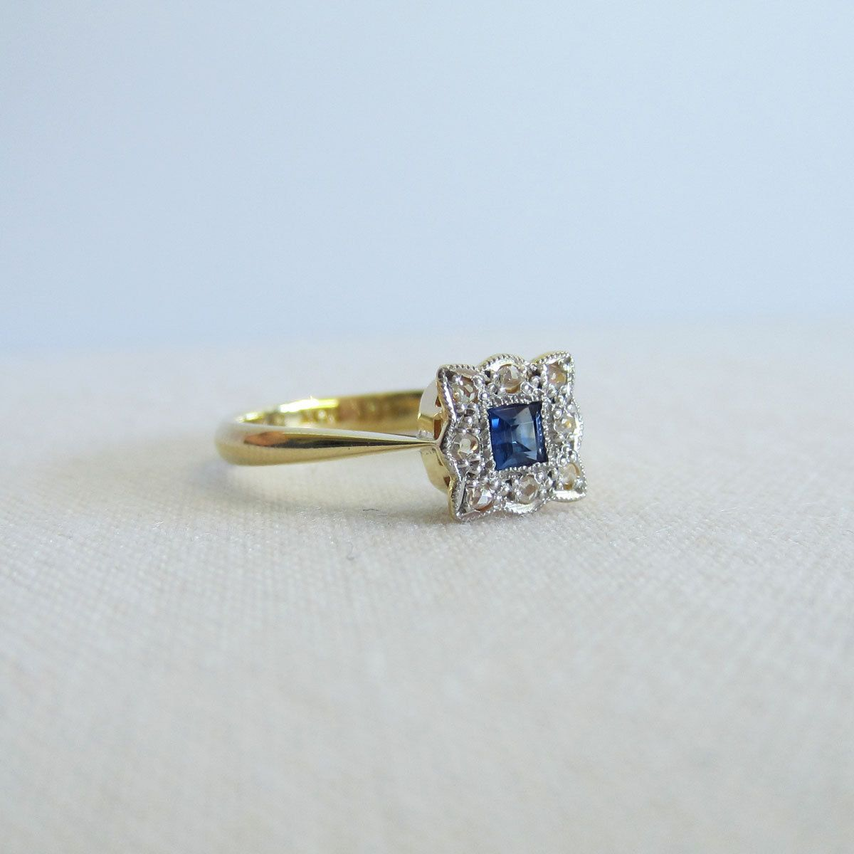 vintage engagement ring. sapphire with diamond halo, circa 1920s