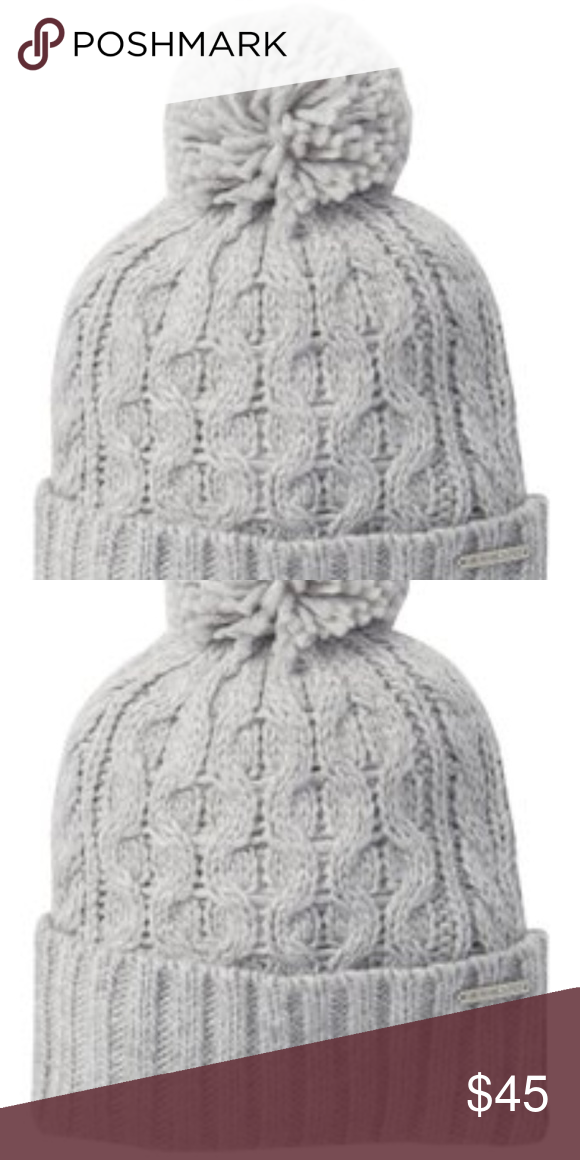 faba244b5c4df Michael Kors Pompom Cable Knit Beanie Pompom detail - Cable knit  construction - Rib knit folded