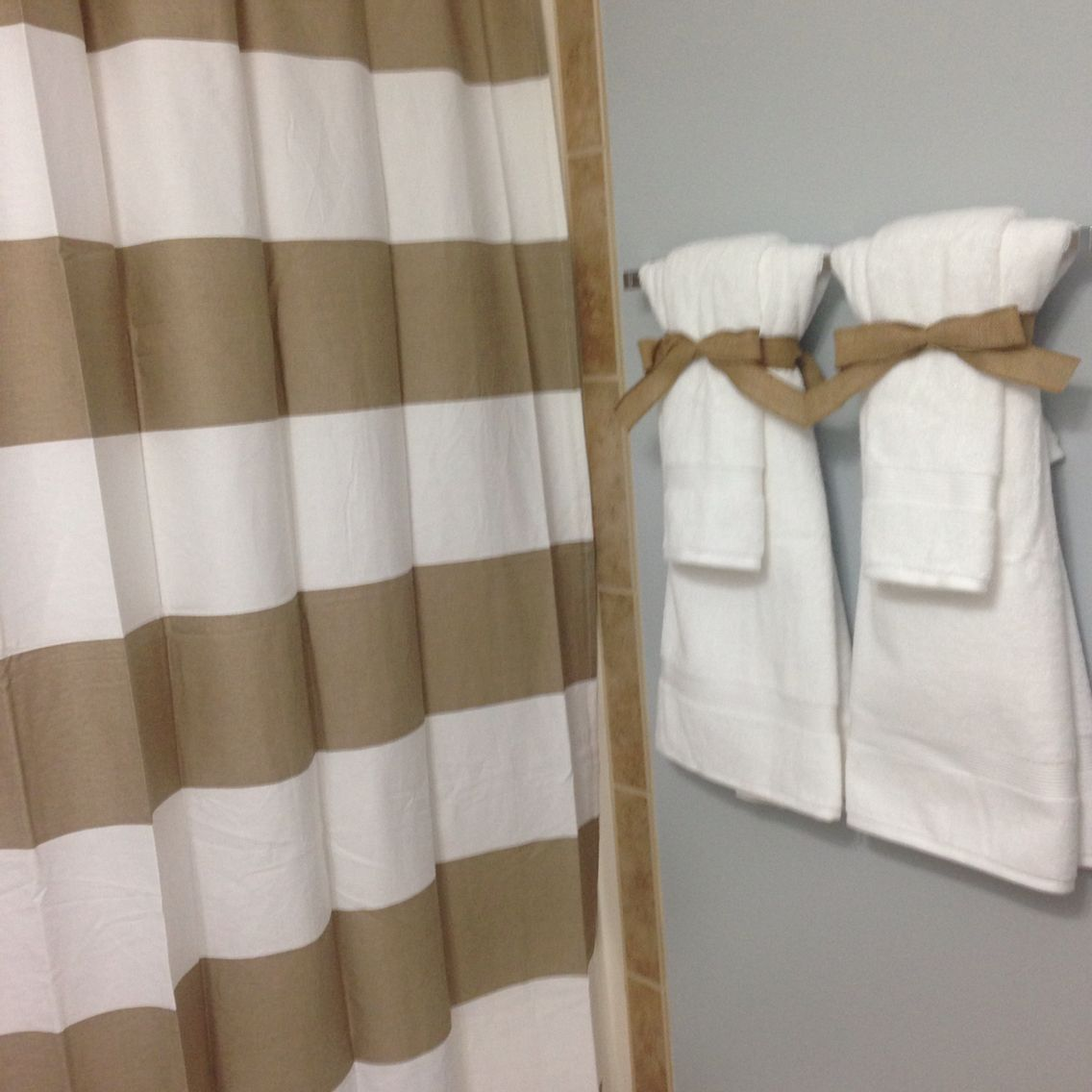 Bathroom staging to sell your home neutral colors crisp for How to tie towels in bathroom