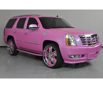 Image from http://www.lcarsmotorcycles.com/wp-content/uploads/2014/11/2007-cadillac-escalade-is-a-pink-2007-cadillac-escalade-suv-in-carrollton-tx.jpg.