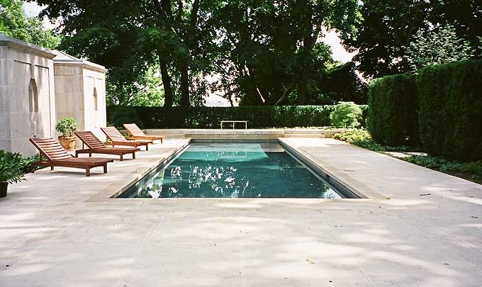 Joe Mimran and Kimberley Newport-Mimran pool by Ronald Holbrook using  Indiana limestone with a patina finish