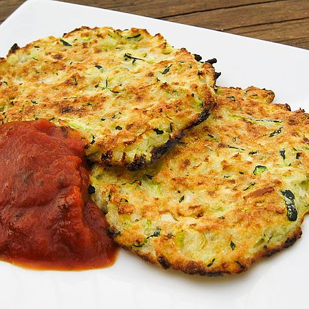 Zucchini fritters... Nom!  Do not use cheese, make substitution like nutritional yeast. Also use whole flour.