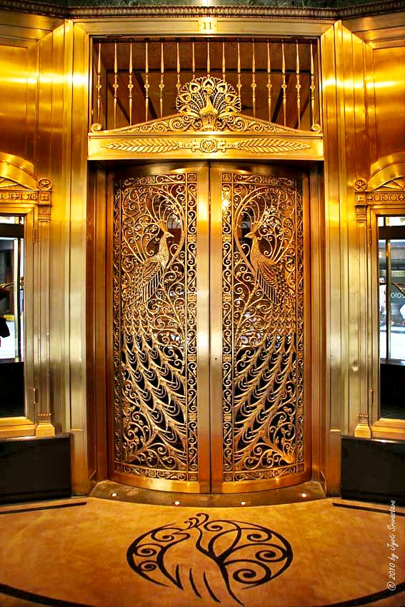 Art deco peacock doors chicago portals of grace for Art deco furniture chicago