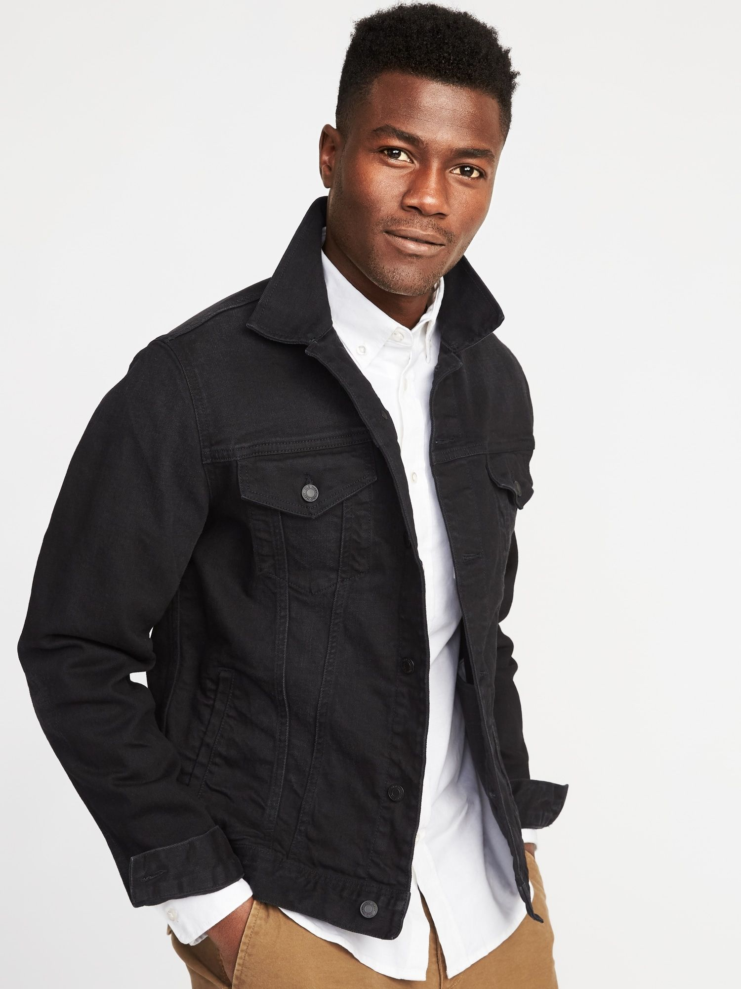 A jet black denim jacket is a striking departure from the